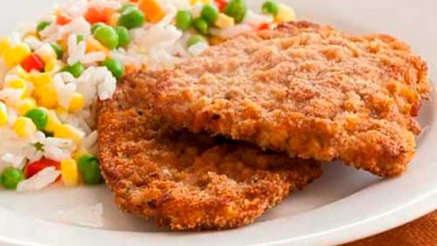 Escalopas de carne con arroz primavera